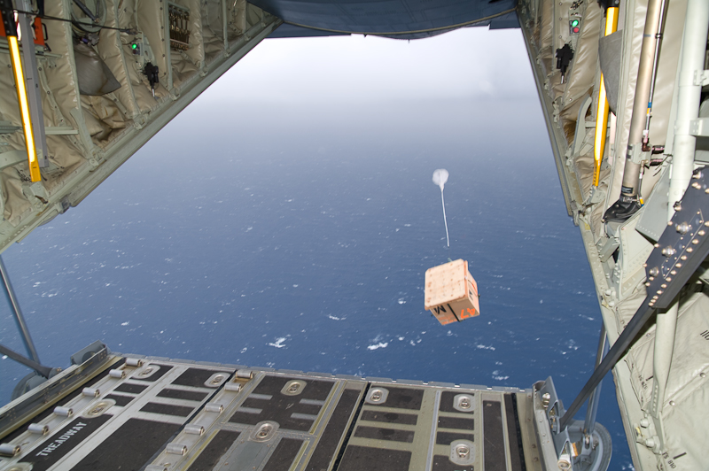 A Hurricane Hunters WC-130J aircraft drops an oceanic data buoy in advance of Hurricane Ike (2008).