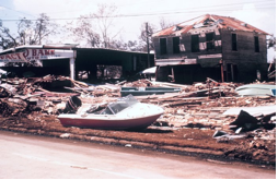A house with debris scattered everywhere